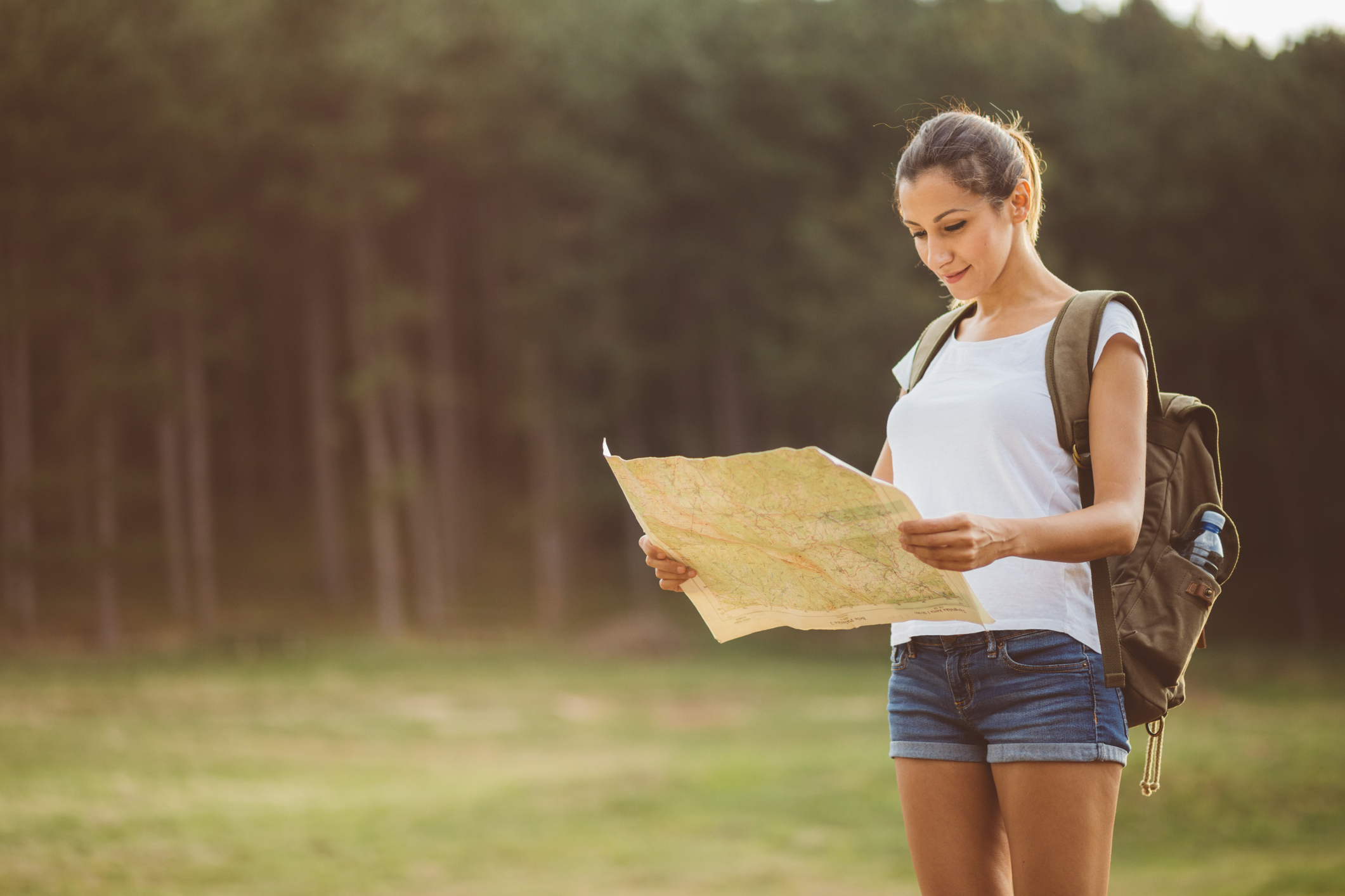 woman looking at a large map
