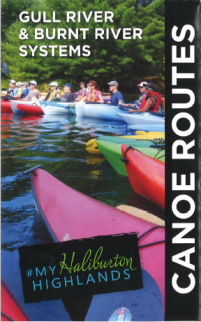 people in kayaks on the cover of the canoe routes map