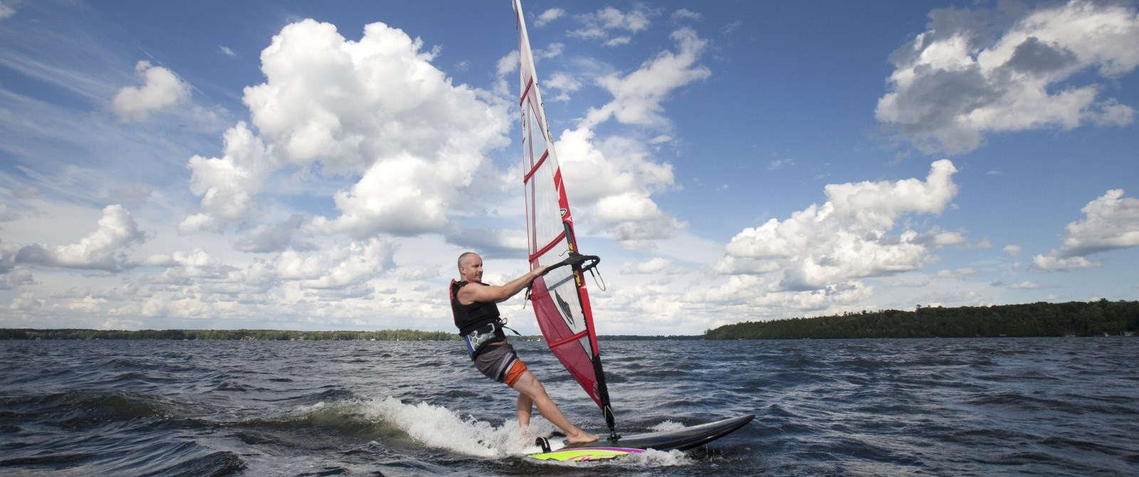 man para sailing on lake