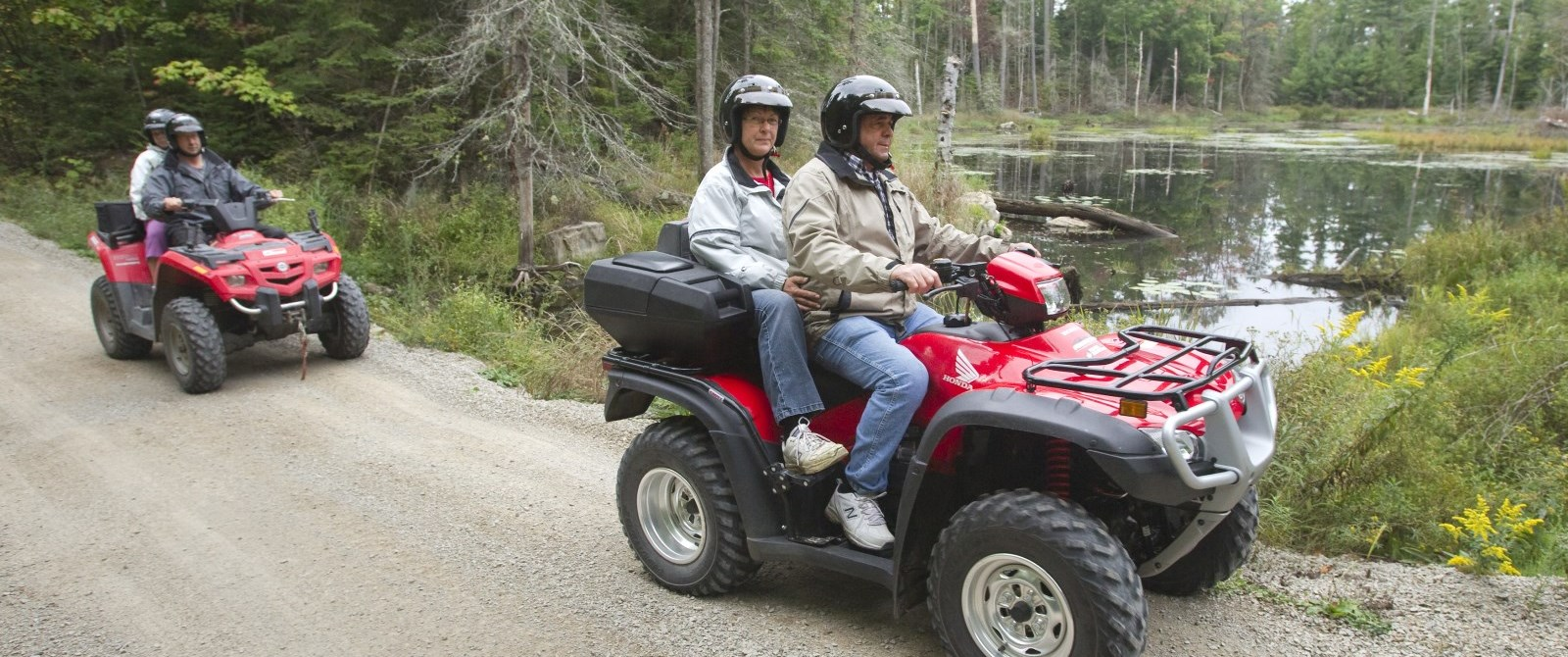 Two ATVs on trail