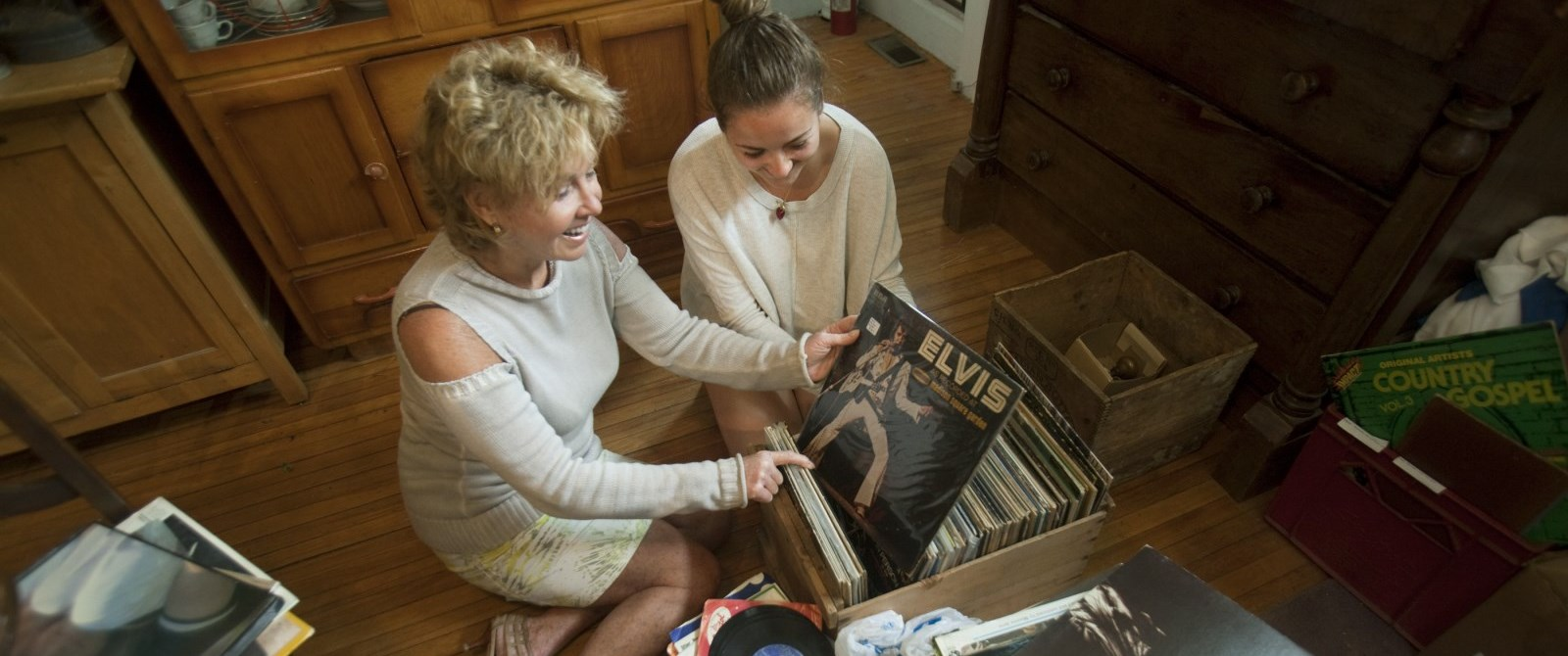Woman and Girl looking at records in an antique shop