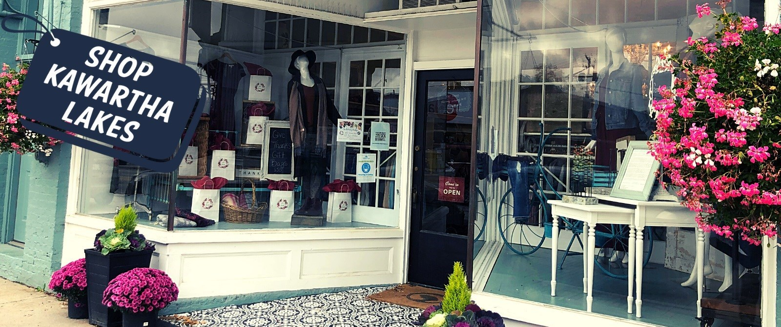 Storefront in fall with shop local message