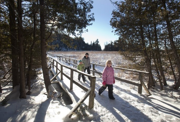 family walking on a winter trail