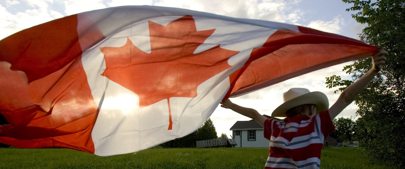 boy running with a Canada flag