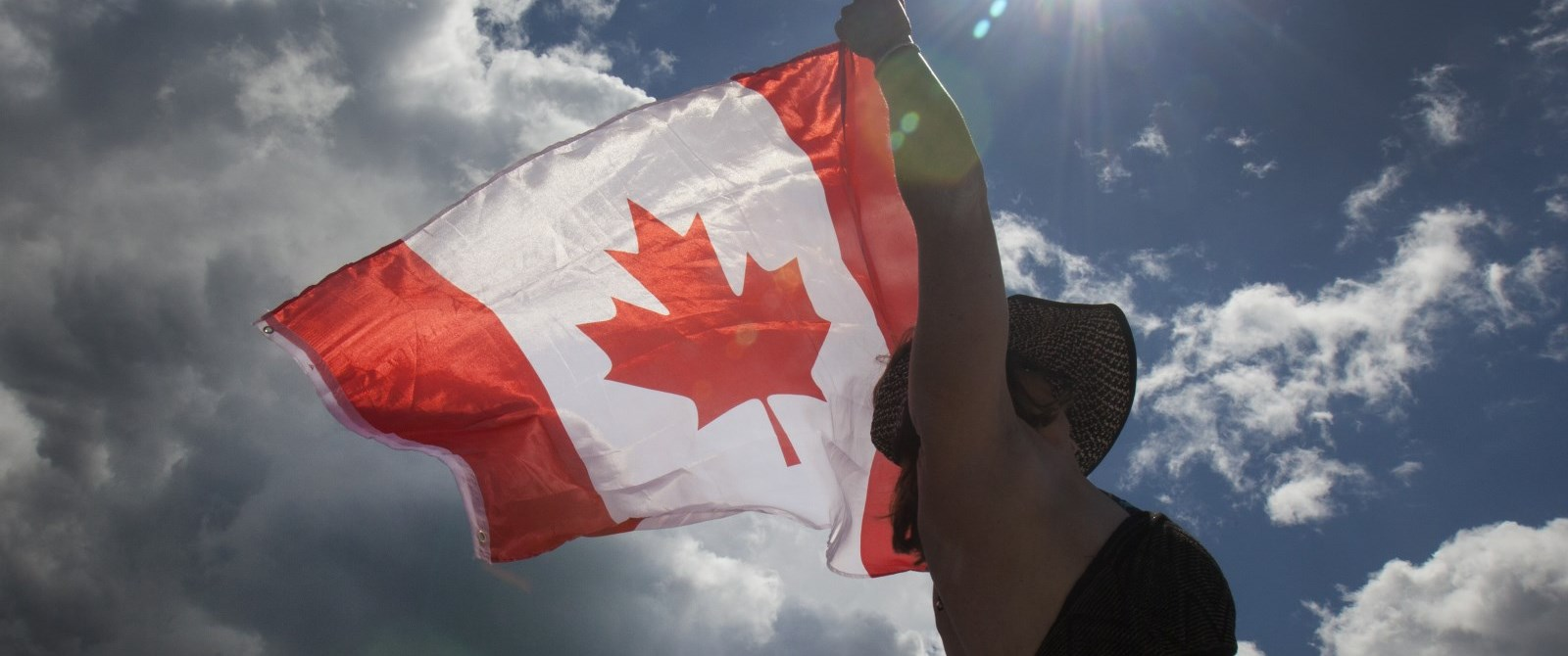 woman holding a canada flag
